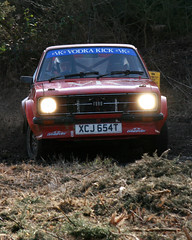Caught in the headlights (mind the goat) Tags: red ford car corner track mud offroad kick rally slide vodka escort rallye sideways wareham 654 vk sunseeker doset powerslide xjc