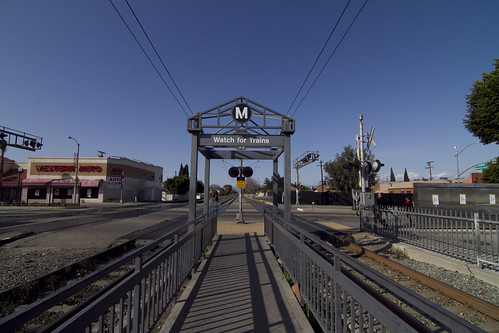 The Florence Station features signage, gates, bells and flashing signals.