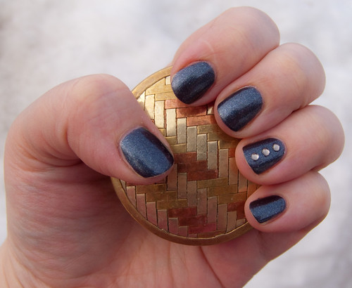 Light grey rhinestones nail design