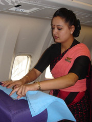 Air Nepal International (Sarene BKK) Tags: travel female work uniform asia aircraft seat flight crew transportation airline service boeing flightattendant