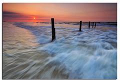 Sunset Waves (Nora Carol) Tags: longexposure sunset seascape beach colors woods waves logs sabah thelight malaysianphotographer minisun beautifulmalaysia noracarol sabahanphotographer melinsungbeach landscapephotographerfromsabah womanlandscapephotographer womaninphotography