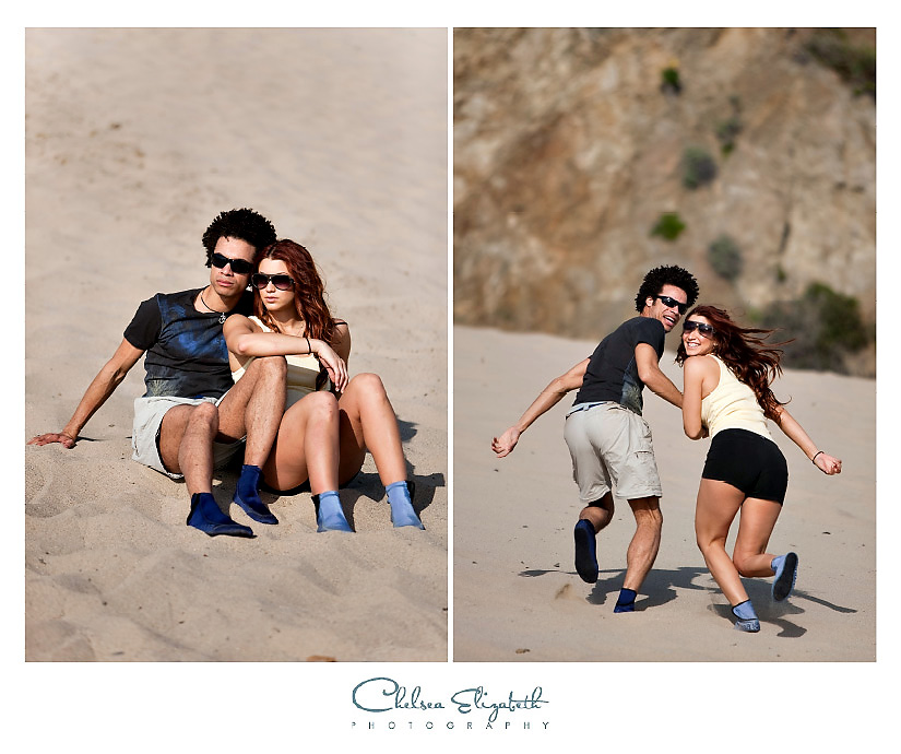 couple playing in the sand malibu beach engagement
