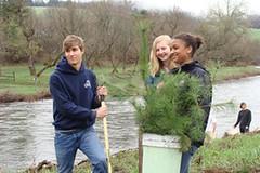Griffin, Finn, and Chelsea reforest riparian habitat