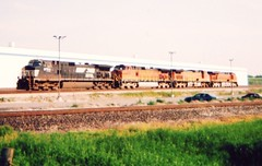Three BNSF Railway and one Norfolk Southern locomotive running light westbound near 67th Street. Hodgkins Illinois. May 2006.