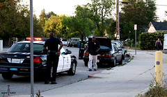 Police and civilians (razorcutgarlic) Tags: life california street city trees people woman man car walking losangeles uniform gun cops candid police ticket neighborhood stop ave cop toyota trunk vehicle law enforcement cruiser siren nestle officer ventura patrol sanfernandovalley blvd holster camry policeman stopped policemen lapd officers uniformed ticketing tarzana ticketed flickrchallengegroup