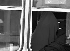 Burka isolation, Cairo (chrisjohnbeckett) Tags: street urban blackandwhite bw woman bus window islam religion egypt hijab cairo hide frame isolation niqab burqa dresscode conceal burka chrisbeckett