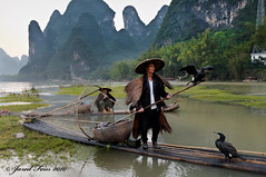 Fishing with Cormorants (1) (SewerDoc (200 Explores)) Tags: china travel mountains reflection birds river cormorants landscape fishing fisherman asia guilin traditional explore limestone raft guangxi guangxiprovince xingping blueribbonwinner riverli flickrexplore explored impressedbeauty theunforgettablepictures sewerdoc jaredfein