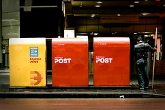 While at his Post (CJ Dias Abeyesinghe) Tags: road city man standing waiting downtown post mail pavement banner sydney australia postbox jumper boxes georgestreet 500d hunched ef50mmf14usm