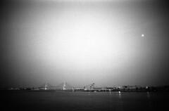 The port of YOKOHAMA (Snap Shooter jp) Tags: leica bridge sea blackandwhite bw moon film monochrome japan port landscape fuji snapshot rangefinder mp nightview yokohama neopan1600 blackdiamond leicaelmarit21mmf28ii flickrestrellas