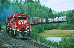 .(SEE & HEAR)---CP 5549 eb 402, Benny, ONT. 9-17-1995 (jackdk) Tags: train railroad railway locomotive emd emdsd40 emdsd402 sd40 sd402 cp cpr canadianpacific benny bennyontario ontario trailertrain standardcab stacktrain seeandhear seehear
