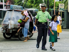 Safely Across (Beegee49) Tags: street traffic enforcer warden children crossing bata bacolod city philippines