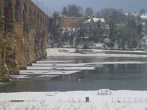 Bridge supports slice ice sheets on River Tweed