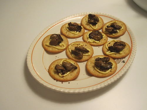 Smoked oysters on crackers with Kewpie and merlot salt