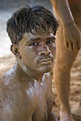 Kusti Fighter (© Jakub Jurkowski) Tags: portrait india man building sport pain eyes sand fighter breast mud martial body traditional arts august dirt varanasi 2008 malla pradesh uttar jakub kushti kusti jurkowski