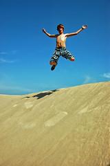A Wild Man Jump (Jeff Clow) Tags: vacation youth fun jump dunes teen gar jeffrclow