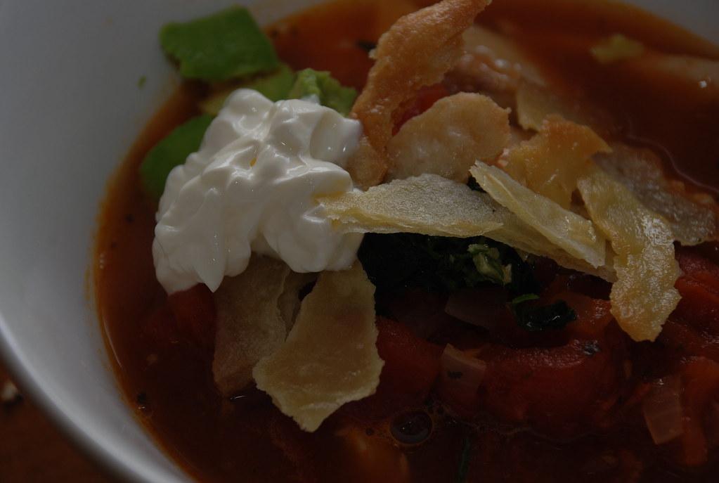 tortilla soup with crema, tortillas, avocado, chicken