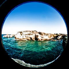 Roca, zona archeologica 20090818-_MG_5438 (Roberto Arleo) Tags: mare blu fisheye salento roca lecce costaadriatica zonaarcheologica