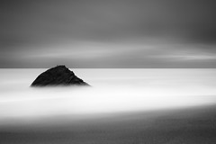en solitaire (maxxsmart) Tags: ocean longexposure winter sea blackandwhite bw seascape bird beach rock clouds canon sand december smooth wideangle minimal lee goldengate bayarea marincounty 2009 blownout marinheadlands gnd 10stopnd bwnd110 5dmarkii lastsunriseoftheyear upperfishermans imtryingtoboreyoutodeath hardedgendgrads reallyimtryingtomakecolorimagesef1740f4l