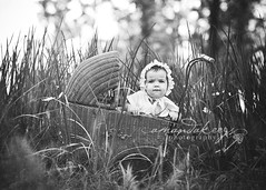Serious ({amanda}) Tags: baby field grass hat mine antique naturallight bonnet bnw pram 7months antiquepram 85mm12l amandakeeysphotography