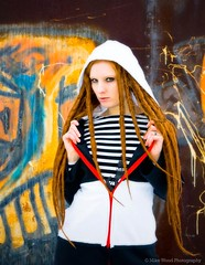 Drednaught #4 (Mike Wood Photography) Tags: red woman wall standing hair eos ginger hoodie rust grafitti steel arr zipper staring striped jaclyn allrightsreserved gripping dreds mikewood 400d mikewoodphotographycom mikewoodphotography