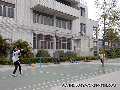 School kids playing badminton
