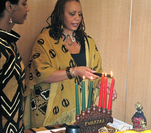 Tabia lights the candles for Kwanzaa