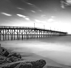 Pier ND110 (NIKON 505) Tags: ocean beach water pier blackwhite rocks northcarolina carolinabeach slowexposure nd110