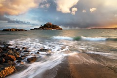 "Mounts Bay, Penzance - A colourful early Spring evening. This image was taken from the slipway looking over towards St.Michaels Mount at Marazion in Cornwall. When the tide is low you can walk over to the mount via a causeway. This image was taken at full tide. Lee 0.6 ND and Lee 0.6 graduated ND filters used for this image. Sorry about the unlevel horizon, I didn't notice this until after I had uploaded the image.  Please  <a href=""http://bighugelabs.com/onblack.php?id=4480069548&size=large"" rel=""nofollow"">View On Black</a> to see the approaching rain clouds more easily."
