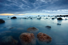 Hot Water Dawn (Mark Emirali) Tags: ocean longexposure blue light sea newzealand sky cloud seascape motion blur colour nature water sunrise landscape rocks waves mood clarity wideangle nz canon5d aotearoa coromandel hotwaterbeach copyrighted 1740f4l gnd pleasedonotusewithoutmypermission maloe4 5dmkii maloephoto maloephotography markemirali markemiraliphotography