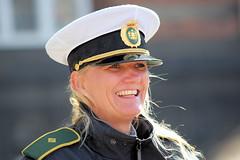 Danish Police Woman (N!els) Tags: portrait people woman girl beauty smile bronze denmark pc bokeh candid police cap 1d blonde policewoman streetphoto danmark dinamarca streetshot constable wpc danemark fotocompetitionbronze