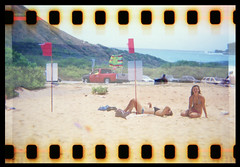 Hawaiian Holga Visions (Justin Ornellas) Tags: ocean justin girls art film beach water beautiful 35mm vintage aka point hawaii holga interestingness interesting lomo lomography mod waves fuji oahu superia south surfing holes retro east iso bikini flip 400  hawaiian sandys portlock sandybeach sprocket halona explored chinawalls ornellas ornellaswouldgo