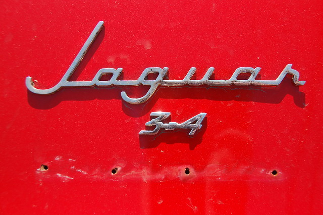Red Jaguar Mark 1 Chrome badge on the trunkboot lid by Chris Devers