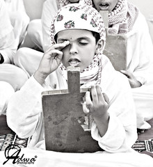 Learning is Freedom (Adwa Abdullah Al_Dhawi) Tags: portrait bw monochrome daylight blackwhite culture innocence learning littleboy saudiarabia canon450d traditionalschool saudiculture aljanderyeh femalesaudiphotographer adwaphotography learningisfreedom