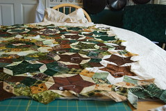 Pinning goes fast with an itty bitty quilt (domesticat) Tags: baby quilt pins pinning basting