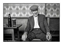 """Albert's Obituary (Peter Dewhurst) Tags: albert obituary roseandcrown darnall sheffield southyorkshire glass bottle beer fag ciggy bh smoke table cap flathat film trix d76 nikonf2 documentary 1977 """"socialdocumentary"""" portrait 28mm"""