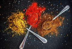 Beautiful color of spices (glavash) Tags: red brown yellow spices salt pepper curry spoon
