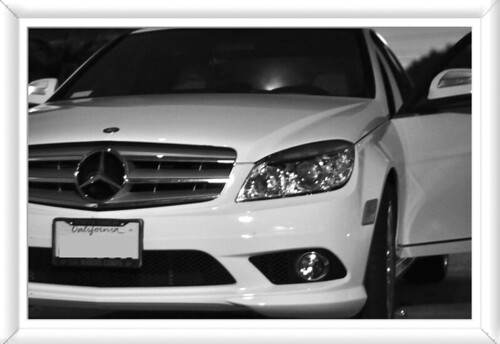 Black and white white mercedes shot at night using low aperture with Nikon