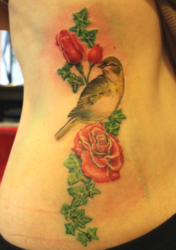 bird with roses and ivy tattoo