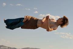 Sleeping in the Clouds (naturalturn) Tags: shirtless usa man michael jump jumping nevada trampoline burningman blackrockcity esplanade leap 2009 leaping burningman2009 image:rating=5 image:id=080712