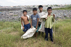 Stung Mean Chey Dump Site, Cambodia - Tira and friends (Mio Cade) Tags: boy sky cloud love girl work children hope site pain garbage asia cambodia peace sister brother dream dump soul rubbish endurance phnom sacrifice scavenger penh stungmeanchey
