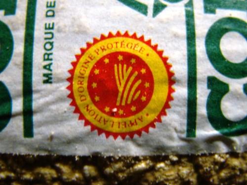 Selo da indicação geográfica (denominação de origem) do queijo Comte.