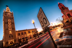 wide bright traffic and lights (ericbowers) Tags: sunset signs lights evening holidays dusk christmaslights kansascity motionblur missouri canon5d speedlimit giralda trafficsigns hdr countryclubplaza plazalights traffictrails wetpavement ericbowers canon1635lii