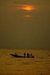 DSC01047 (shashank birudavolu) Tags: morning sea sun india beach water sunrise lens boat early fishing fisherman waves fishermen sony tokina catamaran alpha a100 vizag sonya100
