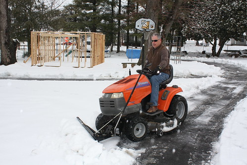 lawn mower in snow