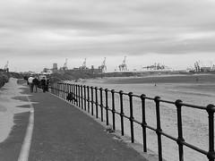 Walking on the promenade (nepygill) Tags: gormley anotherplace ironmen crosbybeach