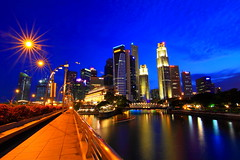 """Singapura"" (Mel Mijares) Tags: light sun lake tourism bulb canon river flyer singapore nightscape esplanade ndp destination cbd bluehour fullerton merlion goldenhour boatquay touristspot singapura 2010 clarkequay bulbexposure"