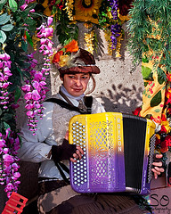 The Accordian Player (scottnj) Tags: street flowers woman paris france lady colorful montmartre streetperformer accordian performer beautifulphoto scottnj