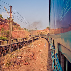 Along the Track (christian.senger) Tags: travel blue sky brown india digital train geotagged dangerous nikon asia track outdoor stones goa canyon powerline distance lightroom d300 christiansenger:year=2010
