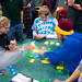 Students playing Dutch Blitz during Late Night in the Commons.