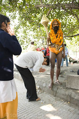 A Naga baba blesses hindu devotees at the Kumbh Mela, Haridwar, India (sanjayausta) Tags: pictures people india men saint festival naked nude religious photography bath asia nudes indian faith religion festivals traditions smoking full blessing holy pot exotic photographs gathering take warrior ritual procession bathing nudity marijuana population devotees hindu hinduism dip festivities maha crowds baba bless sanjay babas largest sadhu 2010 naga rituals mela nagas haridwar the photoessay throngs austa sadhus kumbh photodocumentary ascetics